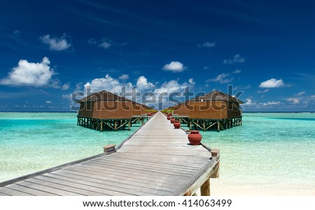 water bungalows on the maldives - stock photo