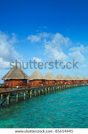 water bungalows over the ocean - stock photo