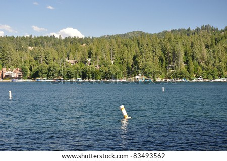 Water buoys mark out areas for boats on Lake Arrowhead in Southern California.