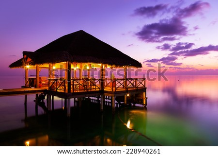 Water cafe at sunset - Maldives vacation background - stock photo
