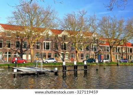 Water canal and traditional buildings in the old town of Delft, Holland