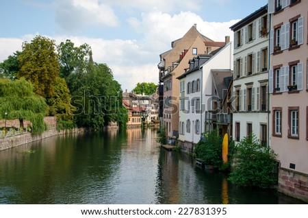 Water canal in Petite France area in the beautiful city of Strasbourg. - stock photo
