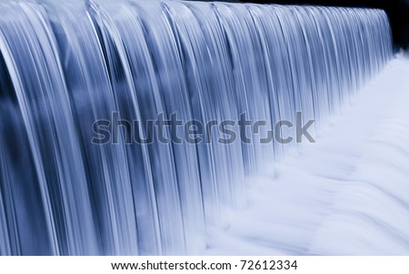 water cascade streaming down a lasher, cool white balance, concept for water saving, conservation, keeping water clean