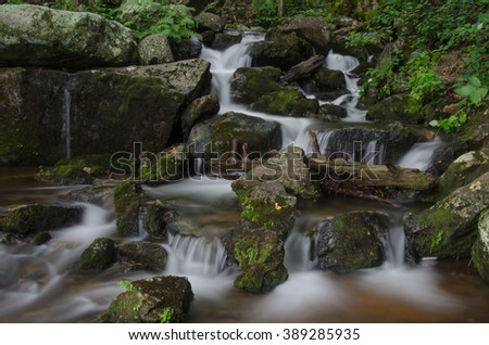 Water cascading over rocks after passing over Crabtree Falls - stock photo