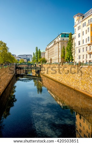 Water channel with Zollamtssteg bridge in residential district in Vienna