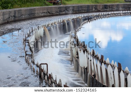 Water cleaning in settlers at wastewater treatment plant - stock photo