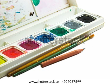 Water color box, brushes and pencil isolated on white background
