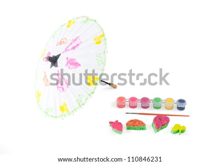 Water color paint boxes and paint brush with painted umbrella - stock photo
