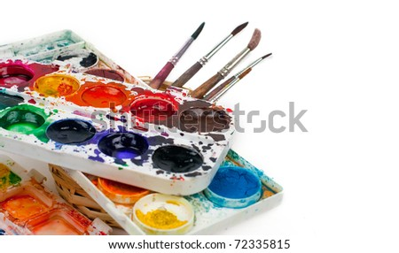Water color paints on a white background and a brush
