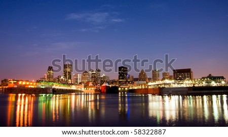 Water Color reflection and Downtown Montreal background at Dusk