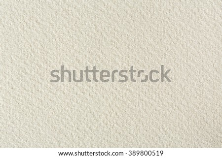 Water-colour paper texture background in light beige tone. - stock photo