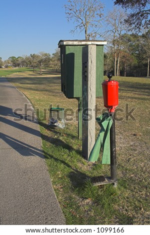 Water cooler, ball washer and trash bin side of golf cart path
