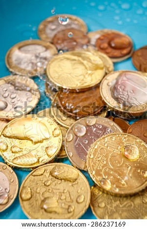 Water Cost with euro currency coin and water drops, vertical studio shot - stock photo
