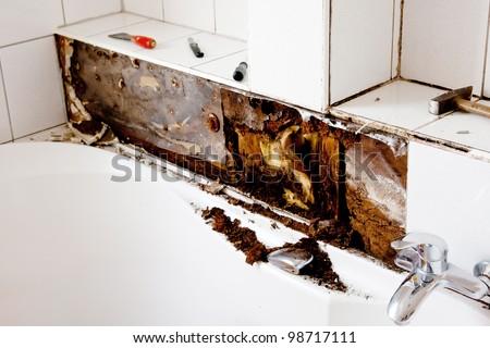 Water damage in bathroom - stock photo