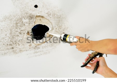 Water damaged ceiling - stock photo