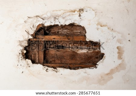 Water damaged ceiling in an old abandoned house. - stock photo