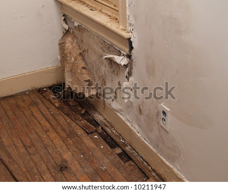 water damaged interior wall in an old house - stock photo
