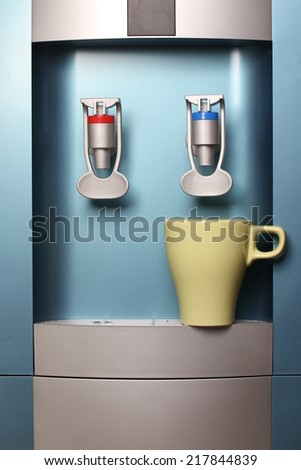 water dispenser and cup, water cooler - stock photo