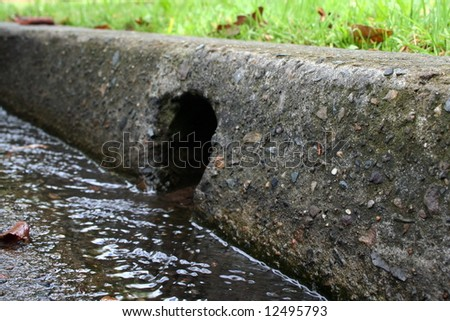 Water draining into a gutter
