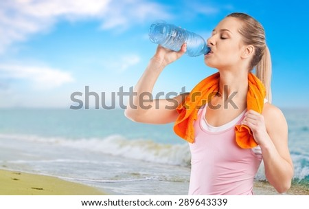 Water, drink, woman. - stock photo