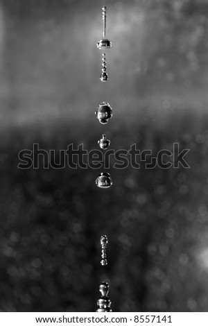 water dripping from a tap and forming droplets