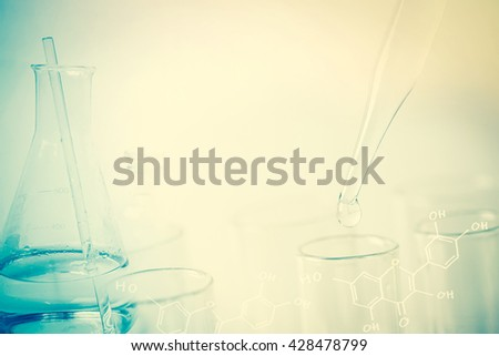 water drop and laboratory for natural chemistry concept - stock photo
