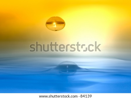 Water drop descending onto silky smooth water surface, duotone by filter - stock photo