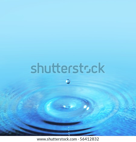 Water drop falling into a fresh blue body of water - stock photo
