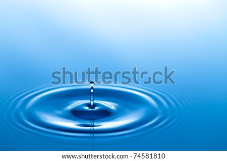 Water  drop falling to a liquid surface - stock photo
