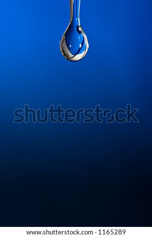 Water drop on blue background