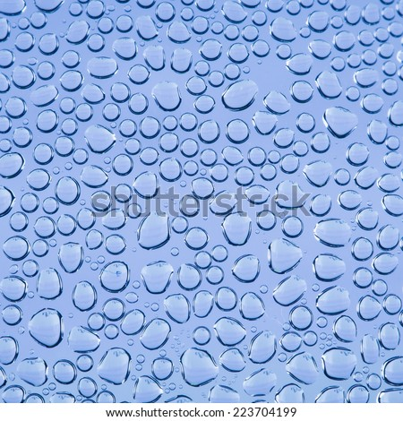 water drop on blue background - stock photo