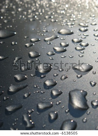 Water drop on car roof - stock photo