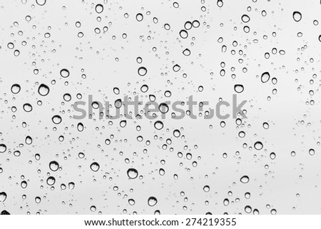 Water drop on glass mirror background. - stock photo