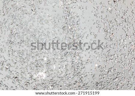 Water drop on gray background. - stock photo
