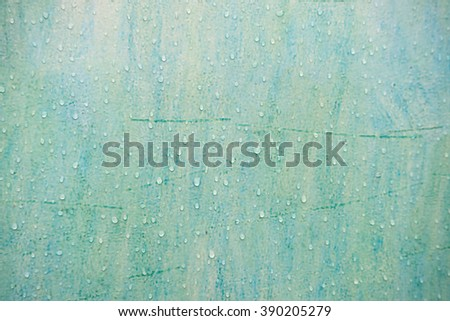 Water drop on green painted wall background. - stock photo