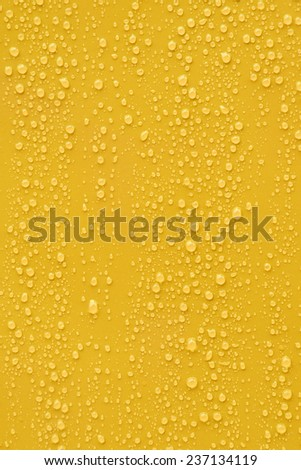 Water drop on orange background. - stock photo