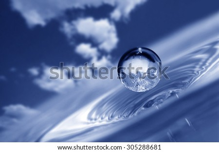 water drop on sky background - stock photo
