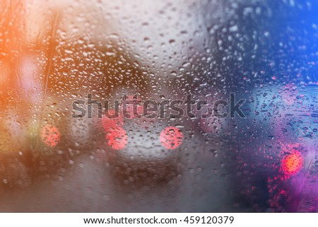 water drop on window glass car with lighting effect filter - stock photo