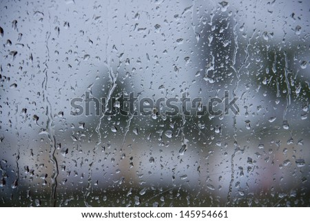 water drop, rain drop on glass and dripping down - stock photo