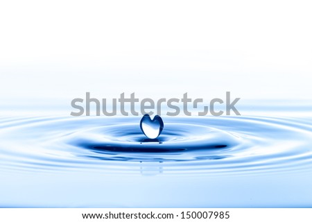 Water droplet in heart shape - stock photo