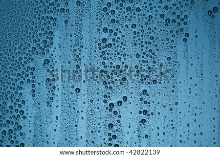 Water droplets on a blue background