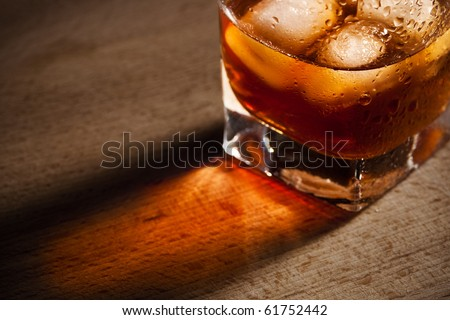 water droplets on a glass of whiskey