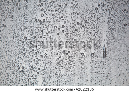 Water droplets on a gray background - stock photo