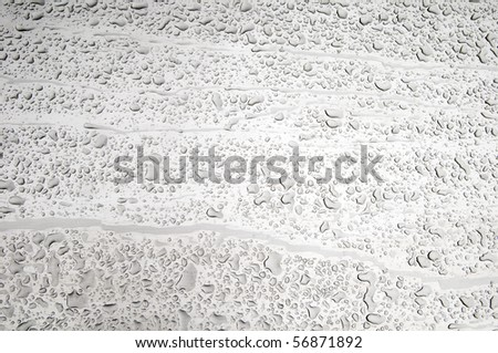 Water droplets on a metal background. - stock photo