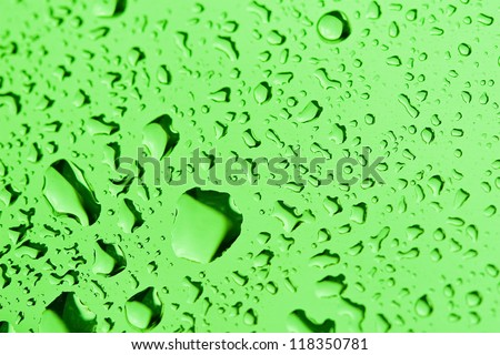 Water Droplets on a metal Surface - stock photo