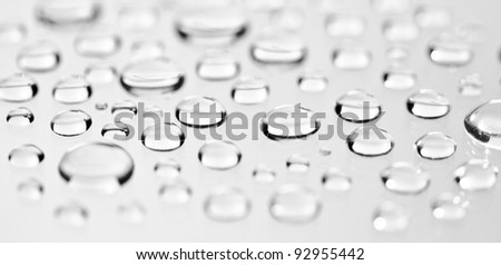Water droplets on a white background. Macro shot.
