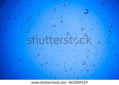 Water droplets on blue glass for a background, Drops of water