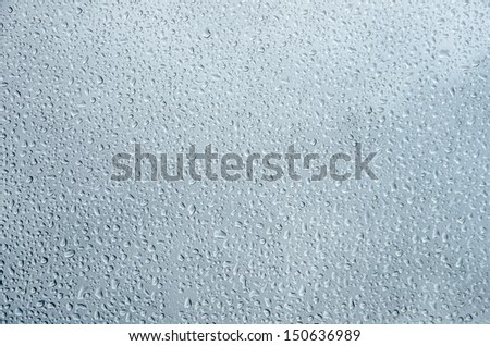 Water droplets on glass background. - stock photo