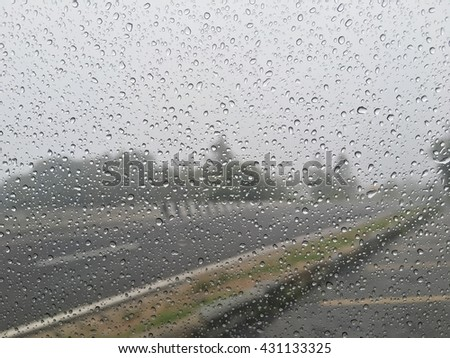Water droplets on glass background Road. - stock photo