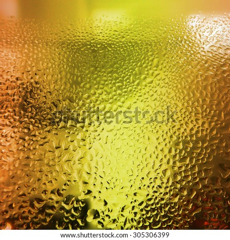 Water droplets on glass  bottle of juice background. - stock photo